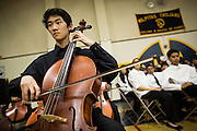Gordon Luu, MHS senior, plays the Cello during the Milpitas Unified School District's 11th Annual Music Festival at Milpitas High School in Milpitas, California, on April 10, 2014. (Stan Olszewski/SOSKIphoto)