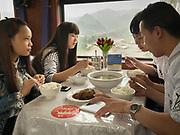 Friends going to a wedding to Lanzhou. Life in the train Hong Kong to Urumqi, Xinjiang.
