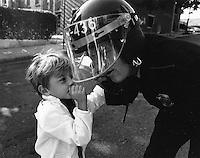 child with a Boston policemen, 1975