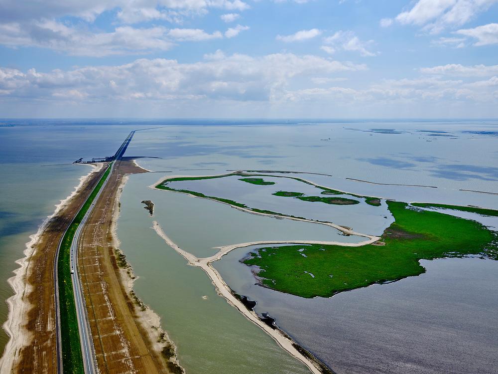 Nederland, Flevoland, Markermeer, 07-05-2021; Trintelzand, nieuw aangelegd natuurgebied gelegen tegen de westelijke zijde van de Houtribdijk. Het gebied ligt tussen tussen de vluchthaven Trintelhaven (links aan de dijk) en Enkhuizen. Moerasgebied voor vogels en vissen, met zandplaten, slikvelden en rietoevers. Het Trintelzand wordt gerealiseerd binnen het project Versterking Houtribdijk, en is onderdeel van het Nationaal Park Nieuw Land<br /> Trintelzand, newly constructed nature reserve next to the Houtribdijk. Marsh area for birds and fish, with sandbanks, mudflats and reed banks.<br /> luchtfoto (toeslag op standard tarieven);<br /> aerial photo (additional fee required)<br /> copyright © 2021 foto/photo Siebe Swart