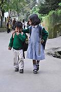 Young children in uniform on the way to school Darjeeling, West Bengal, India