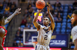 Dec 1, 2018; Morgantown, WV, USA; West Virginia Mountaineers guard Brandon Knapper (2) shoots a three pointer during the second half against the Youngstown State Penguins at WVU Coliseum. Mandatory Credit: Ben Queen-USA TODAY Sports