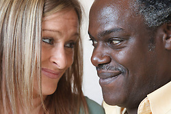 Portrait of couple smiling. Cleared for Mental Health issues.