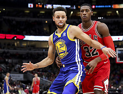 January 17, 2018 - Chicago, IL, USA - Chicago Bulls guard Kris Dunn (32) defends against Golden State Warriors guard Stephen Curry (30) during the first half at the United Center in Chicago on Wednesday, Jan. 17, 2018. The Warriors won, 119-112. (Credit Image: © Armando L. Sanchez/TNS via ZUMA Wire)