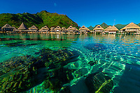 View of the overwater bungalows in the lagoon from inside the reef, Hilton Moorea Lagoon Resort, island of Moorea, Society Islands, French Polynesia.