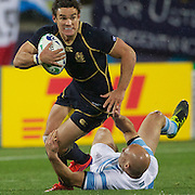 Max Evans, Scotland, is tackled by Filipe Contepomi, Argentina,  during the Argentina V Scotland, Pool B match at the IRB Rugby World Cup tournament. Wellington Regional Stadium, Wellington, New Zealand, 25th September 2011. Photo Tim Clayton...