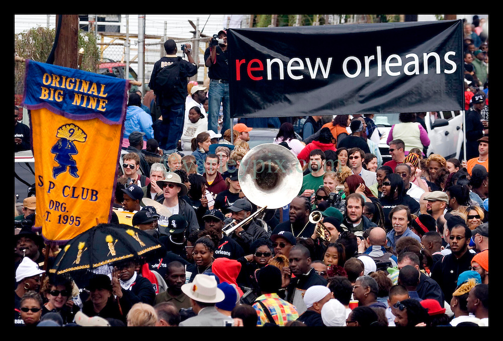 15th, Jan, 2005. New Orleans, Louisiana. A coalition of 27 social aid and pleasure clubs join forces for a second line parade with the Rebirth Jazz band reclaiming the streets of New Orleans.