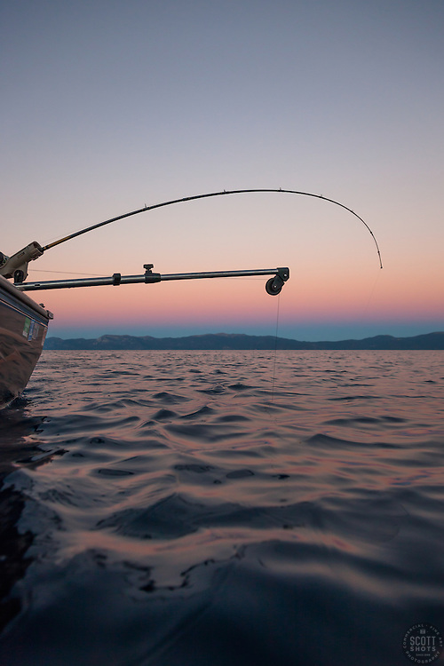 """""""Sunset Fishing on Lake Tahoe 8"""" - Photograph of a fishing pole and downrigger at sunset on Lake Tahoe, on the East Shore."""