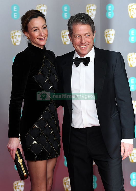 Anna Eberstein and Hugh Grant attending the 73rd British Academy Film Awards held at the Royal Albert Hall, London. Photo credit should read: Doug Peters/EMPICS Entertainment