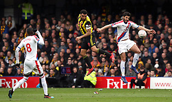 Watford's Troy Deeney (centre) heads towards goal during the FA Cup quarter final match at Vicarage Road, Watford.