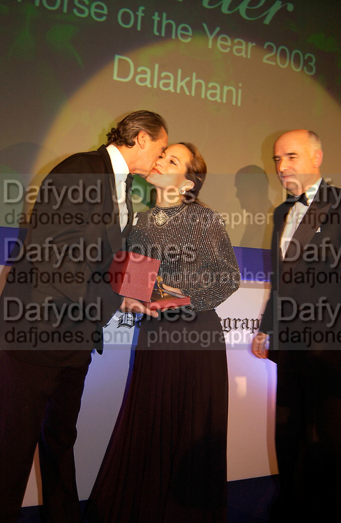 Arnaud Bamberger presenting the Cartier Horse of the Year Award to Princess Zahra Aga Khar and the trainer Alain de Royer Dupre  for the horse Dalakhani, , Cartier Racing Awards 2003. four Seasons hotel, 12 November 2003. © Copyright Photograph by Dafydd Jones 66 Stockwell Park Rd. London SW9 0DA Tel 020 7733 0108 www.dafjones.com