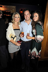 Left to right, ISABELLE COATEN, JAMIE MURRAY-WELLS and LADY NATASHA RUFUS-ISAACS at the Tatler Magazine Little Black Book party at Tramp, 40 Jermyn Street, London SW1 on 5th November 2008.