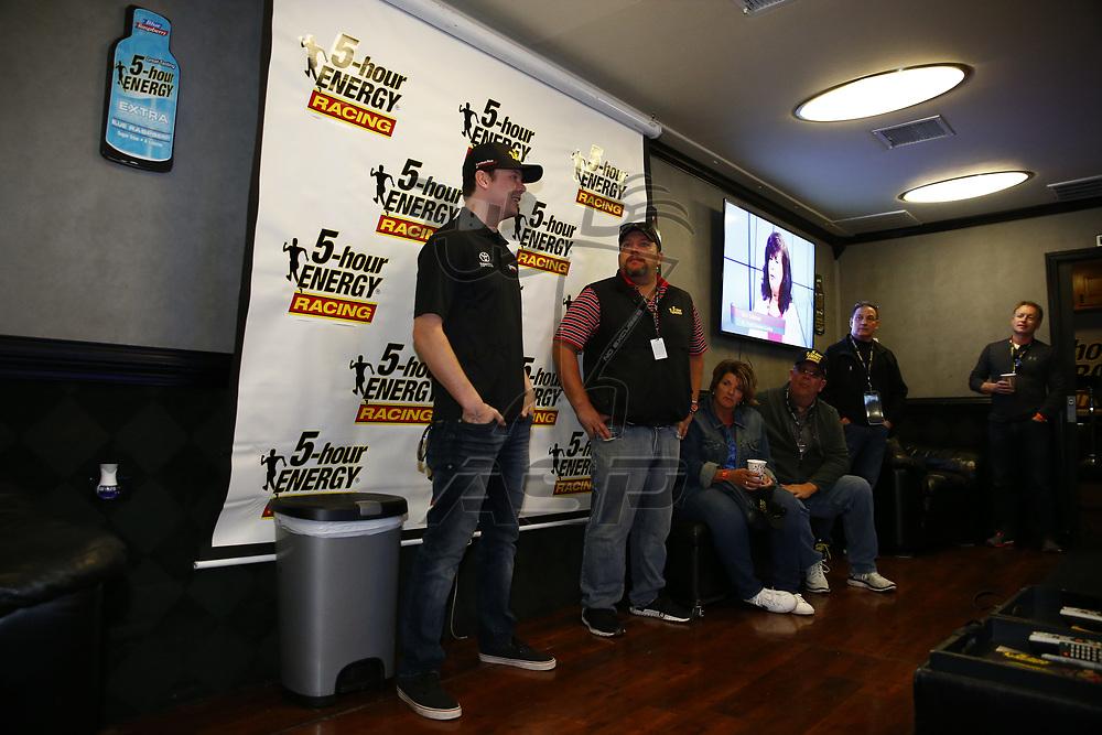 October 22, 2017 - Kansas City, Kansas, USA: Erik Jones (77) takes photos with sponsors prior to the green flag for the Hollywood Casino 400 at Kansas Speedway in Kansas City, Kansas.