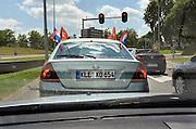 Nederland, Nijmegen, 13-6-2014Een auto met duits kenteken heeft nederlandse vlaggetjes in de ramen vanwege het wereldkampioenschap voetbal. Ziet er vreemd uit, maar is een nederlander die vlak over de grens woont in Duitsland...Foto: Flip Franssen/Hollandse Hoogte
