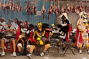 """""""Los Chivos"""", goats, take a rest at the mayordomo's house during the fiestas of Acatlán, Mexico. The mayordomo, who has been in charge of the holy cross for a year, is expected to feed hundreds of people while the celebration lasts.  In early May the people of this small community leave offering for Santa Cruz.  They also maintain the ancient tradition of fighting in jaguar masks. This is a pre-Columbian tradition in which the blood and sweat that fall to the ground are an offering to earth.  In return for their blood the people ask the gods for rain."""