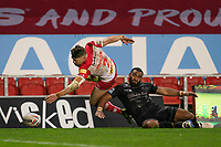 Rugby League - 2020 Betfair Super League - Semi-final - St Helens vs Catalan Dragons - TW Stadium<br /> <br /> St. Helens's Tom Makinson is tackled by Catalans Dragons's Samisoni Langi<br /> <br /> COLORSPORT/TERRY DONNELLY
