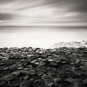 The Giants Causeway in Northern Ireland. 40,000 interlocking basalt columns, the result from an ancient volcanic eruption. They looked like little stepping stones placed by someone, leading to a turbulent sea.