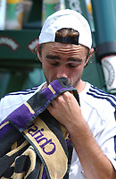 Olivier Mutis (France) reflects on his 5 set defeat to Paradorn Srichaphan (Thai) after having 2 match points. Wimbledon Tennis Championship, Day 3, 25/06/2003. Credit: Colorsport / Matthew Impey DIGITAL FILE ONLY