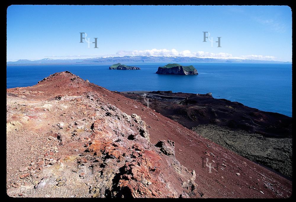 View of Bjarnarey Island, Ellidaey Island and Eyjafjall Glacier from Eldfell volcano; Westman Is Iceland