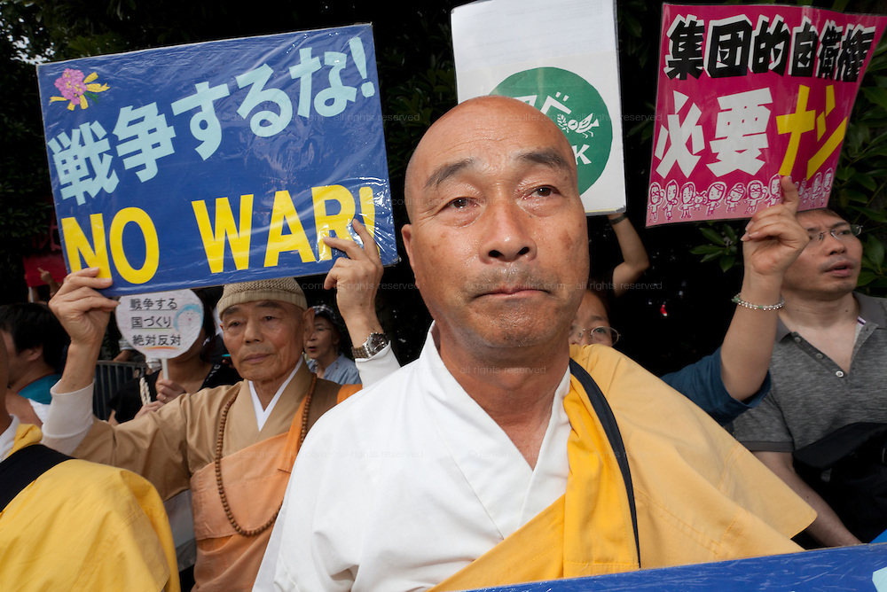 Buddist monks at a protest against the revision of article 9 of the Japanese Constitution outside the Prime-Minister's house in Kasumigasaki, Tokyo, Japan. Monday June 30th 2014. Over 10,000 people showed their support for Japan's unique peace constitution and called on the government to halt its reinterpretation of Article 9 allowing Collect Self Defence which is expected to become law on July 1st