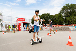 30.07.2017, Donauinsel, Wien, AUT, FIVB Beach Volleyball WM, Wien 2017, im Bild ein Kind mit einem Segway am Bikemite Stand // a child with a segway at the bikemite booth during the 2017 FIVB Beach Volleyball World Championships at the Donauinsel in Wien, Austria on 2017/07/30. EXPA Pictures © 2017, PhotoCredit: EXPA/ Sebastian Pucher