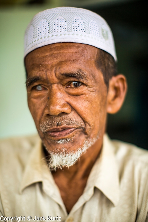 24 OCTOBER 2012 - PATTANI, PATTANI, THAILAND:  Muslim man in Pattani, Thailand. More than 5,000 people have been killed and over 9,000 hurt in more than 11,000 incidents, or about 3.5 a day, in Thailand's three southernmost provinces and four districts of Songkhla since the insurgent violence erupted in January 2004, according to Deep South Watch, an independent research organization that monitors violence in Thailand's deep south region that borders Malaysia. Muslim extremists are battling the Thai government and its symbols, like schools and Buddhist facilities.    PHOTO BY JACK KURTZ