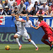 Clint Dempsey, (left), USA, in action against Ozan Tufan, Turkey, during the US Men's National Team Vs Turkey friendly match at Red Bull Arena.  The game was part of the USA teams three-game send-off series in preparation for the 2014 FIFA World Cup in Brazil. Red Bull Arena, Harrison, New Jersey. USA. 1st June 2014. Photo Tim Clayton