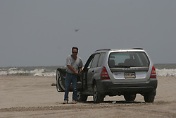 13 May 2010. Elmer Island, Lafourche Parish, Louisiana. <br /> Lee Celano arrives on the beach as oil starts arriving on the baches from the Deepwater Horizon catastrophe on the beaches. <br /> Photo credit; Charlie Varley/varleypix.com