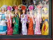 elegantly dressed souvenir Barbie dolls displayed in a window China