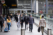With most shops now open but with retail sales suffering due to the Coronavirus pandemic, young men wearing face masks, which became compulsory in shops on the 24th July, walk down the ramp outside John Lewis in the city centre on 5th August 2020 in Birmingham, United Kingdom. Coronavirus or Covid-19 is a respiratory illness that has not previously been seen in humans. While much or Europe has been placed into lockdown, the UK government has put in place more stringent rules as part of their long term strategy, and in particular social distancing.