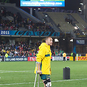 An injured Quade Cooper, Australia, on crutches, during the Australia V Wales Bronze Final match at the IRB Rugby World Cup tournament, Auckland, New Zealand. 21st October 2011. Photo Tim Clayton...