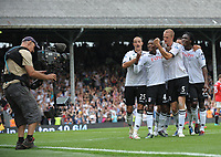 Craven Cottage, Fulham v Manchester United, Premier League 22/08/2010<br />  Brede Hangeland of Fulham celebrates with teamates in front of the TV camera after making the score 2-2 <br /> Photo Marc Atkins  Fotosports International