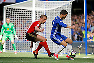Chelsea Midfielder Eden Hazard (10) keeps the ball from Sunderland Midfielder Lee Cattermole (6) during the Premier League match between Chelsea and Sunderland at Stamford Bridge, London, England on 21 May 2017. Photo by Andy Walter.