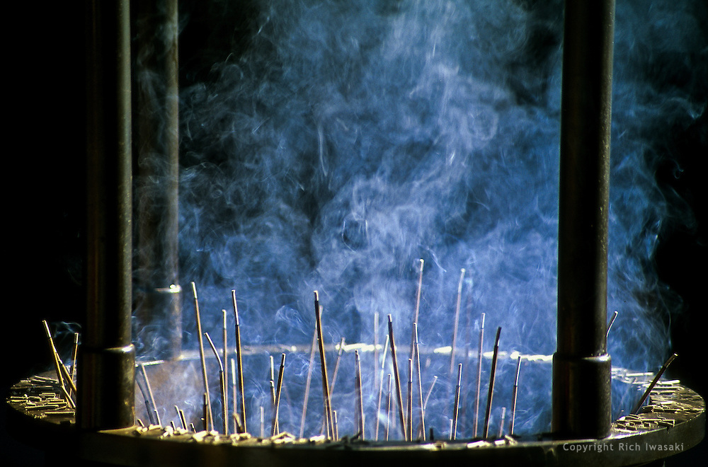 Incense burns in a vessel near the entrance to Sanzen-in (temple) in Ohara city, Kyoto Prefecture, Japan