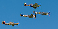 Spitfires and other World War II aircraft take of from Goodwood airfield near Chichester as the country marked the 75th anniversary of the Battle of Britain. <br /> Picture date Tuesday 15th September, 2015.<br /> Picture by Christopher Ison. Contact +447544 044177 chris@christopherison.com