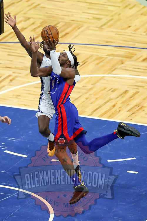 ORLANDO, FL - FEBRUARY 23:  Jerami Grant #9 of the Detroit Pistons charges to the net against James Ennis III #11 of the Orlando Magic during the second half at Amway Center on February 23, 2021 in Orlando, Florida. NOTE TO USER: User expressly acknowledges and agrees that, by downloading and or using this photograph, User is consenting to the terms and conditions of the Getty Images License Agreement. (Photo by Alex Menendez/Getty Images)*** Local Caption *** Jerami Grant; James Ennis III