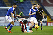 Joey Barton of Burnley (c) looks to tackle Cole Skuse of Ipswich Town (r). Skybet football league Championship match, Burnley v Ipswich Town at Turf Moor in Burnley, Lancs on Saturday 2nd January 2016.<br /> pic by Chris Stading, Andrew Orchard sports photography.