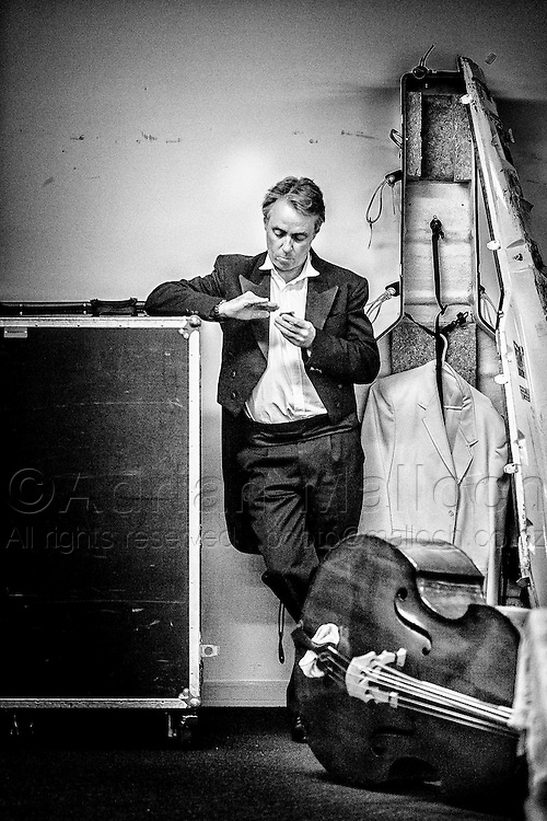 Gordon Hill, Auckland Philharmonia Orchestra Bass section principal, prepares in the Green room for the upcoming concert in the Auckland Town Hall.