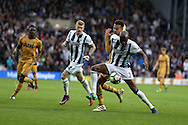 Allan Nyom of West Bromwich Albion holds off Dele Alli of Tottenham Hotspur .Premier league match, West Bromwich Albion v Tottenham Hotspur at the Hawthorns stadium in West Bromwich, Midlands on Saturday 15th October 2016. pic by Andrew Orchard, Andrew Orchard sports photography.