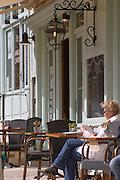 woman at a cafe place du marche saint emilion bordeaux france