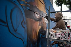 April 14, 2018 - Curitiba, Brazil - CURITIBA, PR - 14.04.2018: GRAFITE LULA - Artist paints the caricature of former president Lula, in a wall in the center of Curitiba. Works is part of the Streets of Styles event, which has graphite, music and dance acts that take place on Saturday and Sunday in the historical center of the capital of Paranà (Credit Image: © Henry Milleo/Fotoarena via ZUMA Press)