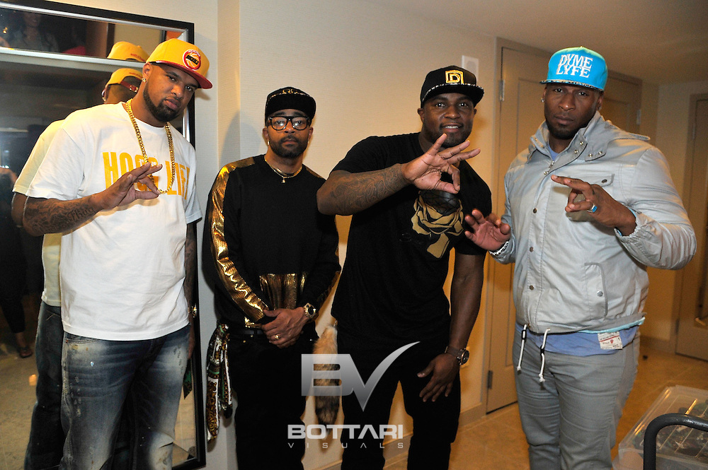 """LAS VEGAS, NV - FEBRUARY 19:  (L-R) Rapper """"Slim Thug"""" Stayve Jerome Thomas, CEO of Flaucy Nate Willis, CEO of DYMELYFE DJ Williams and former NFL player Demetrin Veal, attend the FlauSachika Groups exclusive magic suite party at Aria Resort & Casino at CityCenter on February 19, 2013 in Las Vegas, Nevada.  (Photo by Jeff Bottari/WireImage)"""