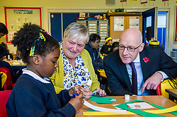 Pictured: <br /> Deputy First Minister John Swinney visited Craigroyston Primamry School today to present the latest batch of Read, Write, Count bags to pupils and parents.  The Scottish Book Trust's published their research on their impact <br /> Ger Harley | EEm 6 November 2018