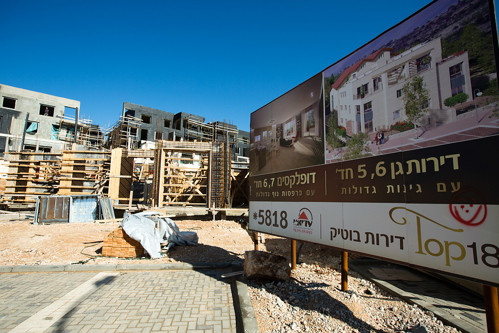 A general view of construction work and a billboard depicting the future houses which are to be built in Givat HaTamar neighborhood of the West Bank Jewish settlement of Efrat in the Gush Etzion settlement bloc, which is situated on the southern outskirts of the Palestinian West Bank city of Bethlehem, on December 30, 2016.