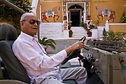 Rawat Nahar Singhji, also known as Rao Saheb, drives his old american Jeep into his family's Fortress - Palace, Deogarh Mahal, now a heritage hotel, Udaipur, Rajasthan, India.