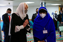 © Licensed to London News Pictures. 07/04/2021. London, UK. Camilla, Duchess of Cornwall wearing a protective face covering and a headscarf gestures as she meets members of the Mosque during a visit to the London Islamic Cultural Society and Mosque (also known as Wightman Road Mosque) in Haringey, north London. The Mosque was formed by a small group of Guyanese Muslims and now supports over 30 different nationalities and community in Haringey and surrounding boroughs. Photo credit: Dinendra Haria/LNP