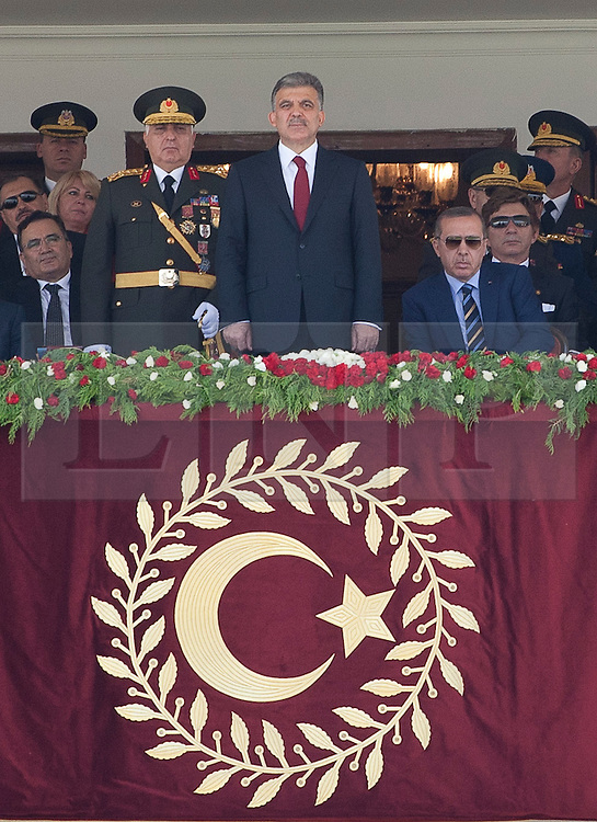 © licensed to London News Pictures. ANKARA, TURKEY  30/08/11. Turkish President Abdullah Gul(center), Turkish PM Recep Tayyip Erdogan (right) and the commander of the Turkish Armed Forces (left) at the 30th August Turkish Victory Day celebrations in capital Ankara. Please see special instructions for usage rates. Photo credit should read TOLGA AKMEN/LNP