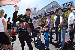 April 8, 2018 - Las Vegas, NV, U.S. - LAS VEGAS, NV - APRIL 08: Leah Pritchett (777 TF) NHRA Top Fuel Dragster high fives after walking off the stage for driver intros during the DENSO Spark Plugs NHRA Four-Wide Nationals on April 08, 2018 at The Strip at Las Vegas Motor Speedway in Las Vegas, NV. (Photo by Chris Williams/Icon Sportswire) (Credit Image: © Chris Williams/Icon SMI via ZUMA Press)