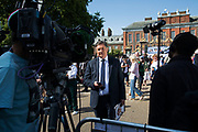 On the 20th anniversary of the death of Princess Diana, crowds of people gather to pay their respects, and to lay flowers, pictures and messages at the memorial to her on 31st August 2017 at Kensington Palace in London, United Kingdom. BBC correspondent and newsreader Simon McCoy reports from the scene. Diana, Princess of Wales became known as the Peoples Princess following her tragic death, and now as in 1997, thousands of royalists, and mourners came to her royal residence in remembrance.