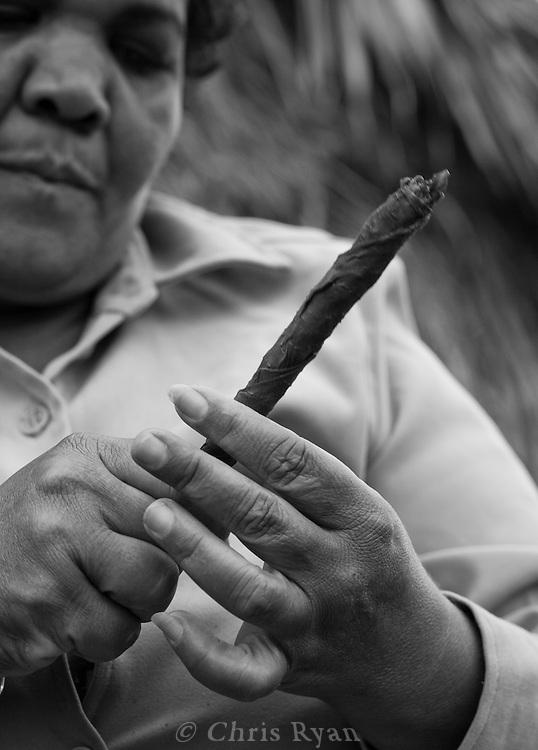 Woman rolling tobacco for a cigar, Vinales Valley, Cuba